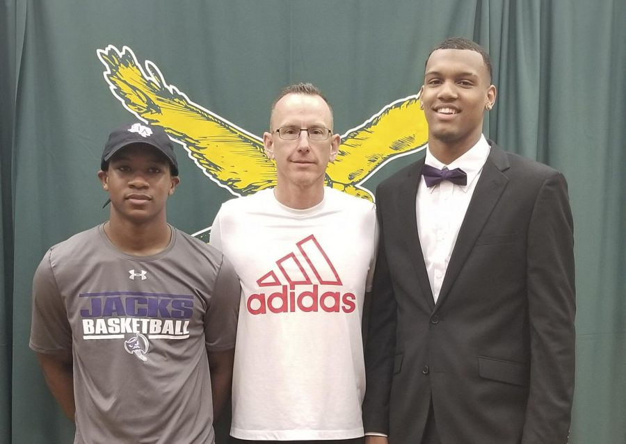 Kharee McDaniel and Calvin Solomon pose with KF basketball coach Cary Black after signing with Stephen F. Austin State University.