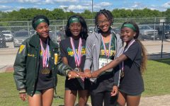 Kayla Meyers, Chelsea Heggar, Charnay Derrick, and A'Niya Galloway take the baton to the State Meet.
